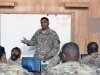 Spc. Vineeth Amaram, 12th Combat Aviation Brigade, Task Force Ready production control database administrator, a native of Hyderabad, India, teaches a math class encompassing probability and statistics in a classroom in the TF Ready footprint in Balkh Province, Afghanistan on Nov. 14. U.S. Army Photo by Sgt. Duncan Brennan, 101st CAB public affairs