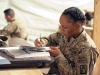 Spc. Jalisa Mitchell, B Company, 4th Battalion, 12th Combat Aviation Brigade, Task Force Ready avionics equipment repair, a native of Dallas, Texas takes notes during a class session covering probability and statistics in a classroom in the TF Ready footprint in Balkh Province, Afghanistan Nov. 14. U.S. Army Photo by Sgt. Duncan Brennan