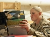 Spc. Liza Happel, D Company, 5th Battalion, 158th Aviation, Task Force REady air frame mechanic, a native of Allentown, Pa., reads over the days material prior to math class in a classroom on the TF Ready Footprint in Balkh Province, Afghanistan Nov. 14. U.S. photo by Sgt. Duncan Brennan, 101st CAB public affairs
