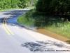 Water creeping over Wildlife Road.