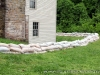 A line of sandbags protecting the base of the Surrender House / Dover Hotel.