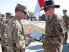Pfc. Nathan Skeen, A Troop, 2nd Squadron, 17th Cavalry Regiment receives an Army Commendation Medal and an Army Achievement Medal from Lt. Col. Bill Ryan, commander, 1st Battalion, 101st Combat Aviation Brigade, Task Force No Mercy during an awards ceremony on the flightline at Forward Operating Base Salerno, Afghanistan, Jan. 23, 2013. (U.S. Army photo by Sgt. Duncan Brennan, 101st CAB public affairs)
