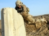 """Staff Sgt. Robert Dodge, a cavalry scout assigned to Troop B, 1st Squadron, 33rd Cavalry Regiment, 3rd Brigade Combat Team """"Rakkasans,"""" 101st Airborne Division (Air Assault), hurls himself over a cement wall during the obstacle course portion of the brigade noncommissioned officer and Soldier of the quarter competition on Forward Operating Base Salerno, Afghanistan, Feb. 15, 2013. Competitors were timed on performing a five mile road march as well as complete five stations throughout the competition. (U.S. Army photo by Spc. Brian Smith-Dutton, Task Force 3/101 Public Affairs)"""