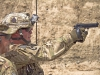 KHOWST PROVINCE, Afghanistan â?? U.S. Army Spc. Sean C. Poole, an infantryman with 2nd Battalion, 506th Infantry Regiment, 4th Brigade Combat Team â??Curraheeâ?, 101st Airborne Division (Air Assault), fires an M9 at a target while competing for Soldier of the Quarter at forward operating base Salerno, Afghanistan, July 14, 2013. (U.S. Army photo by Sgt. Justin A. Moeller, 4th Brigade Combat Team Public Affairs)