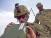 """U.S. Army Spc. Christian Walker, a cavalry scout with 1st Squadron, 61st Cavalry Regiment, 4th Brigade Combat Team \""""Currahee\"""", 101st Airborne Division (Air Assault), participating in the Soldier of the Quarter contest, puts a Single Channel Ground and Airborne Radio System, Advanced System Improvement Program, radio into operation at forward operating base Salerno, Afghanistan, July 14, 2013. (U.S. Army photo by Sgt. Justin A. Moeller, 4th Brigade Combat Team Public Affairs)"""