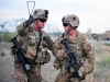 U.S. Army 1st Lt. Andrews Kearns, left, a platoon leader for the 2nd platoon, Whiskey Company, 2nd Battalion, 506th Infantry Regiment provides direction to Pvt. 1st Class Bryce Mickelson during a mass casualty exercise at Forward Operating Base Salerno, Khost province, Afghanistan, Aug. 6, 2013. (U.S. Army photo by Maj. Kamil Sztalkoper/Released)