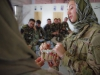 U.S. Army Spc. Kassandra Torres, a dental assistant with 3rd Special Forces Group, shows medics with the ANA's 2nd Commando Khandak, 203rd Corps, the proper way to floss during a basic dental class on at forward operating base Thunder, Afghanistan, July 21. (U.S. Army photo by Sgt. Justin A. Moeller, 4th Brigade Combat Team Public Affairs)