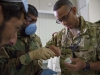 Capt. Abby Raymond, brigade dentist for the 4th Brigade Combat Team, 101st Airborne Division (Air Assault), uses a plaster model he created to show medics with the ANA's 2nd Commando Khandak, 203rd Corps, how to properly extract a tooth, during a basic dental class on at forward operating base Thunder, Afghanistan, July 22. (U.S. Army photo by Sgt. Justin A. Moeller, 4th Brigade Combat Team Public Affairs)