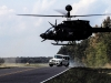 FORT CAMPBELL, KY -- An OH-58 Kiowa Helicopter from the 159th Combat Aviation Brigade, 101st Airborne Division (Air Assault), attempts to trap stunt driver and Top Gear show host Tanner Foust, during a