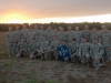Soldiers from F Company, 5th Battalion, 101st Combat Aviation Brigade, 101st Airborne Division (Air Assault,) Pathfinders, pose in front of a setting sun after completing the final jump for the Pathfinder company at Fort Campbell, Ky., October 16, 2013. The Soldiers completed an airborne operation that was the last in the 101st Airborne Division\'s history. (U.S. Army photo by Sgt. Duncan Brennan, 101st CAB Public Affairs)