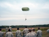 The last jumper from F Company, 5th Battalion, 101st Combat Aviation Brigade, 101st Airborne Division (Air Assault,) Pathfinders, parachutes into the drop zone to the cheers of his fellow companymates during the last jump of the Pathfinder company at Fort Campbell, Ky., October 16, 2013. The jump was the last airborne operation in the history of the 101st Airborne Division. (U.S. Army photo by Sgt. Duncan Brennan, 101st CAB Public Affairs)