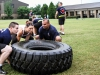 "Soldiers of Company C, 3rd Battalion, 187th Infantry Regiment, 3rd BCT, 101st Airborne Division (Air Assault) ""Rakkasans,"" and Kaime, a FOX Sports Southwest Girl, flipped tires as part of a physical fitness session at U.S. Army Fort Campbell, Ky., Aug. 12. (U.S. Army Spc. Brian Smith-Dutton 3BCT Public Affairs)"