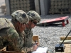 U.S. Army Sgt. 1st Class Felix Matos, left, and Sgt. Nicholas Davis, right, artillerymen with Battery C, 1st Battalion, 320th Field Artillery Regiment, Task Force Strike, reference fires data before a fire mission at Kara Soar Base, Iraq, Aug. 7, 2016. Battery C Soldiers support the Combined Joint Task Force – Operation Inherent Resolve mission by providing indirect fire support for Iraqi security forces as they continue to combat Da'esh and re-take lost terrain. (1st Lt. Daniel I Johnson)