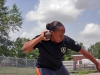 Sgt. Kadina Baldwin heaves a heavy shot put ball July 1, 2014 at Fort Campbell's Fryar Stadium, demonstrating the winning technique she used during the Army Warrior Games trials June 15-20 at the U.S. Military Academy, West Point, New York. Baldwin took the bronze medal in shot put and gold medals in wheelchair basketball and sitting volleyball.  (U.S. Army photo by Stacy Rzepka/RELEASED)
