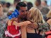 """Specialist Jacob Gonzales from Company A, 1st Battalion, 187th Infantry Regiment, 3rd Brigade Combat Team """"Rakkasans,"""" 101st Airborne Division, is welcomed home by his wife Kimberly and his daughter at Hangar 3 on Fort Campbell, Kentucky June 8, 2015. (U.S. Army photo by Spc. Eric Provost, 3rd BCT Public Affairs)"""