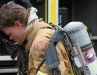 A firefighter removes his scott airpak