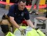 A firefighter folds up his hazmat suit