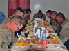Task Force Lifeliner soldiers bow their heads and give thanks during Thanksgiving Day at the Koele Dining Facility, Nov. 28th, 2013, at Bagram Air Field, Parwan province, Afghanistan. The soldiers had the opportunity to celebrate their holiday with a variety of traditional foods. (U.S. Army photo by Sgt. Sinthia Rosario, Task Force Lifeliner Public Affairs)