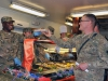 Command Sgt. Maj. Christopher T. Crawford, the 101st Special Troops Battalion command sergeant major, gives Spc. Victor W. Stephans, a mechanic with Task Force Lifeliner, his tray of food while serving lunch at the Koele Dining Facility during Thanksgiving Day, Nov. 28, 2013, at Bagram Air Field, Parwan province, Afghanistan. The Task Force Lifeliner Soldiers had the opportunity to enjoy a bountiful traditional holiday meal. (U.S. Army photo by Sgt. Sinthia Rosario, Task Force Lifeliner Public Affairs)