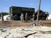 Soldiers with the129th Combat Sustainment Support Battalion, 101st Airborne Division Sustainment Brigade, 101st Airborne Division (Air Assault), fill their Load Handling System Compatible Water Tank Rack, also called a hippo, at the tactical water purification system site pumping stations Sept. 3, 2015, at the Joint Readiness Training Center's Intermediate Staging Base in Alexandria, La. (Sgt. 1st Class Mary Rose Mittlesteadt, 101st Airborne Division Sustainment Brigade (Lifeliners) Public Affairs)