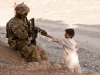 U.S. Army Sgt. Clarence Davis, a forward observer attached to Blue Platoon, Troop B, 1st Squadron, 33rd Calvary Regiment, 3rd Brigade Combat Team, 101st Airborne Division (Air Assault), gives an Afghan boy a pen in Shamal District, Oct. 26, 2012. Part of Troop B's mission was to gather intelligence by engaging the local populace. (U.S Army photo by Sgt. Christopher Bonebrake, 115th Mobile Public Affairs Detachment)