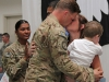 "Spc. Matthew R. Smith, a native of Kill Devil Hills, N.C., and a Military Police with the 551st Military Police Company ""Hooligans,"" 716th Military Police Battalion, 101st Sustainment Brigade ""Lifeliners,""101st Airborne Division (Air Assault), greets his Family with hugs and kisses during a welcome home ceremony April 10, at Fort Campbell. (U.S. Army photo by Sgt. Sinthia Rosario, 101st Sustainment Brigade Public Affairs)"