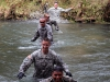 Soldiers from the 163rd Military Police Detachment, 716th Military Police Battalion, 101st Sustainment Brigade, 101st Airborne Division (Air Assault), performs a water crossing in the litter carry portion of the Peacekeeper Challenge Oct. 2, at Fort Campbell, Ky. The Peacekeeper Challenge was an opportunity for the battalion to come together and honor fallen Soldiers in a rigorous physical competition. (U.S. Army photo by Sgt. Leejay Lockhart, 101st Sustainment Brigade Public Affairs)