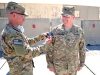 "U.S. Army Col. Val C. Keaveny Jr., commander of the 4th Brigade Combat team ""Currahee"", 101st Airborne Division (Air Assault), receives the 101st combat patch from Command Sgt. Maj. Michael A. Grinston, command sergeant major of the 4th BCT, 101st Abn. Div., during a patch ceremony at Forward Operating Base Salerno, Afghanistan, on June 6, 2013 (U.S. Army photo by Sgt. Justin A. Moeller, 4th Brigade Combat Team Publuc Affairs)"