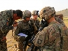 Soldiers with Easy Company, 2nd Battalion, 506th Infantry Regiment, 4th Brigade Combat Team, 101st Airborne Division, discuss details with a member of the Afghan National Army's 2nd Kandak, 1st Brigade, 203rd Corps during a mission in Khowst Province, Afghanistan, on June 2, 2013. (Photo by Sgt. Justin A. Moeller, 4th Brigade Combat Team Public Affairs)