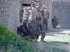 Soldiers with Easy Company, 2nd Battalion, 506th Infantry Regiment, 4th Brigade Combat Team, 101st Airborne Division, pull security while Soldiers of the Afghan National Army's 2nd Kandak, 1st Brigade, 203rd Corps search a residence during a mission in Khowst Province, Afghanistan, on June 2, 2013. (Photo by Sgt. Justin A. Moeller, 4th Brigade Combat Team Public Affairs)
