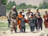 While on patrol, 1st Lt. Brendan D. Murphy of Easy Company, 2nd Battalion, 506th Infantry Regiment, 4th Brigade Combat Team, 101st Airborne Division, talks with the children of a village in Khowst province, Afghanistan, on June 2, 2013. (Photo by Sgt. Justin A. Moeller, 4th Brigade Combat Team Public Affairs)