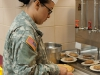Staff Sgt. Davian Dunn, shift leader, E Company, 5th Battalion, 101st Combat Aviation Brigade, 101st Airborne Division (Air Assault), slices turkey in preparation for the Thanksgiving meal at the Son Cafe dining facility on Fort Campbell, Ky., Nov. 26, 2013. (U.S. Army photo by Sgt. Duncan Brennan, 101st CAB Public Affairs)