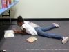 This young lady is enjoying one of her new books in the children\'s section.