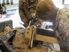 """Spc. Annson Sanders and Spc. Jesseray Leonguerro, both assigned to 1st Battalion, 187th Infantry Regiment, 3rd Brigade Combat Team \""""Rakkasans,"""" 101st Airborne Division (Air Assault), work together to remove heavy duty steel mounting brackets on Forward Operating Base Gardez, Afghanistan, Jan. 24, 2013. A high torque drill is used in order to separate parts. (Spc. Brian Smith-Dutton/U.S. Army)"""