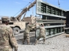 """Soldiers assigned to Company E, 1st Battalion, 187th Infantry Regiment, 3rd Brigade Combat Team \""""Rakkasans,""""\' 101st Airborne Division (Air Assault), work to move a collapsible bridge system in preparation for transport on Forward Operating Base Gardez, Afghanistan, Jan. 24, 2013. The bridge system may be requested at any time and Soldiers are required to have it mission ready at a moment's notice. (Spc. Brian Smith-Dutton/U.S. Army)"""