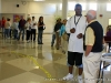 At Clarksville High school Darryl Yates speaks with Precinct Captain Johnny Miller as he awaits his turn to vote.