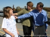 Tim and Linda Barnes point out various signatures on their Daughter Molly\'s shirt.