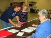 Stacey Kelly and her nine year old daughter signing in to vote.