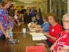 A nurse signs in to vote at Glenellen Elementary School