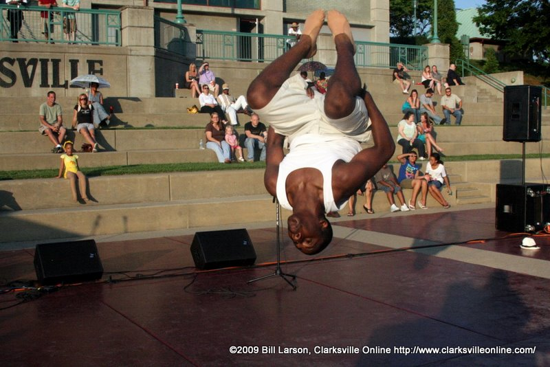 A dancer from Christys Dance Connection does a back flip at the June 13th Concert in the Park