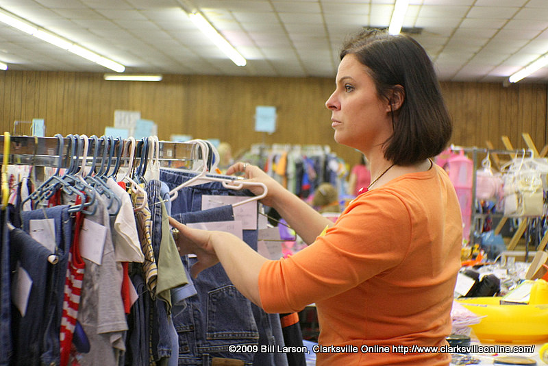 A woman shopping at the Little Lambs and Ivy fall consignment sale
