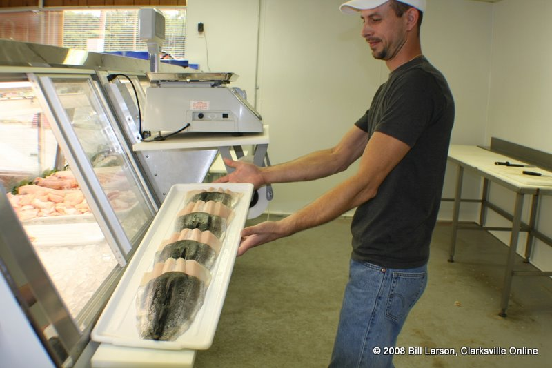 Chris shows off a tray of fresh fish