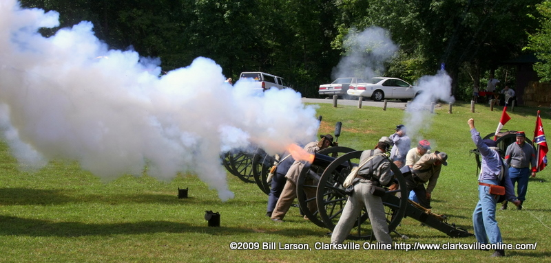 Flame erupts from a canon as it is fired, at the Living History Encampment at Rotary Park