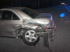 2000 Lincoln LS rolled through a stop sign and in front of the oncoming 2006 Mitsubishi Galant. The Galant hit the Lincoln behind the driver\'s side rear tire area.