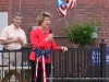 Candidate for Governor Kim McMillan speaking to an attentive crowd