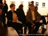 Joyce Norris listens as Jim Robertson relates the story of the collection