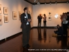 Gallery Director Warren Greene leads a round of applause for Jim Robertson