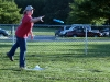 A woman tosses the Frisbee to her son