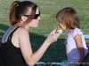 A mom gives her daughter a taste