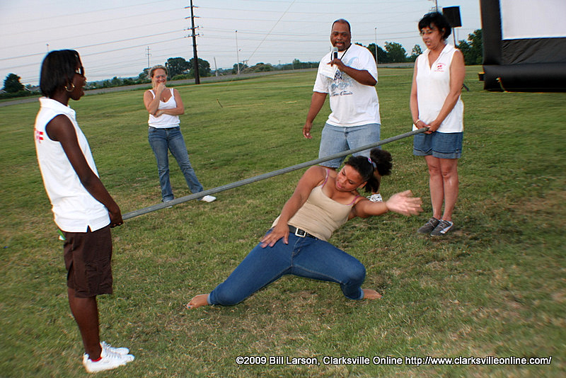 The winner of the Womans Limbo Contest at Movies in the Park